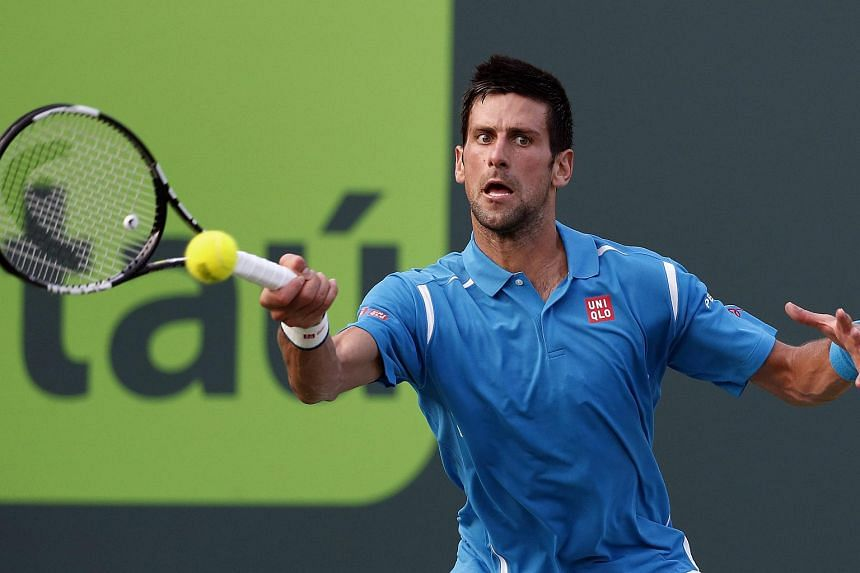 Novak Djokovic of Serbia in action against Joao Sousa of Portugal at the Miami Open, on March 27, 2016.