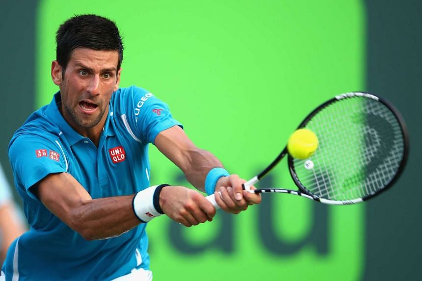 Novak Djokovic plays a backhand against Joao Sousa in their third round match during the Miami Open.