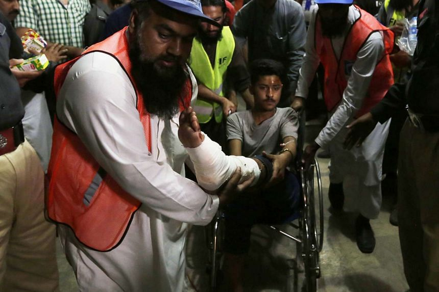 A boy who was injured in a suicide bomb blast leaves after getting medical treatment at a hospital in Lahore, Pakistan.