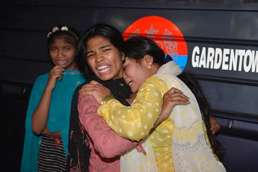 Pakistani women react in horror to the death of relatives in the bomb blast in Lahore on Easter Sunday (March 27).