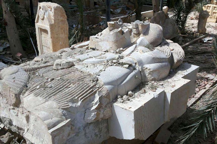 A damaged artefact at the entrance of the museum of the historic city of Palmyra, after forces loyal to Syria's President Bashar al-Assad recaptured the city on Sunday (March 27).