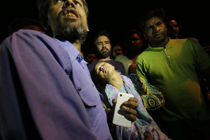 Relatives of the victims of the suicide bomb blast cry outside a hospital in Lahore, Pakistan, on Sunday (March 27).