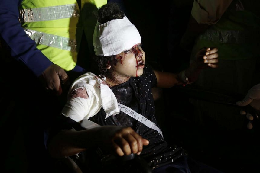 A girl who was injured in the suicide bomb blast is rushed to a hospital in Lahore, Pakistan, on Sunday (March 27).