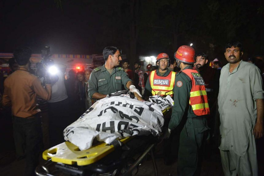 Pakistani rescuers use a stretcher to shift a body from the bomb blast site at a crowded park where many Christians had gone to celebrate Easter in Lahore on Sunday (March 27).