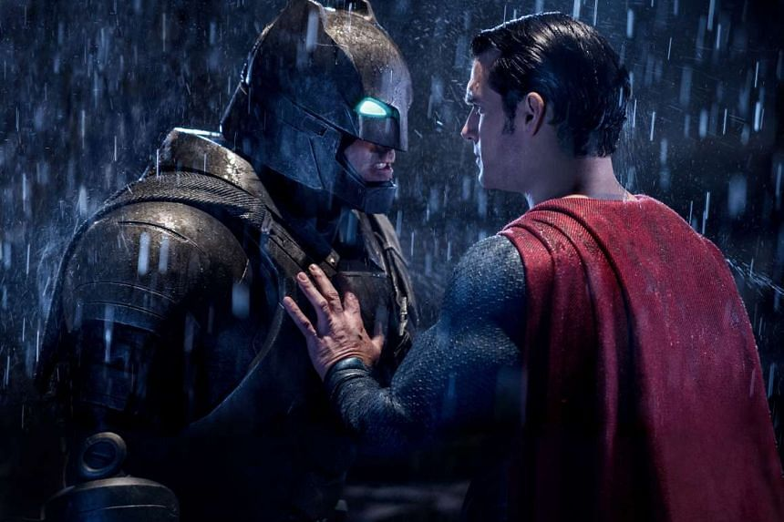 Ben Affleck as Batman faces off with Henry Cavill as Superman in Batman V Superman: Dawn of Justice.