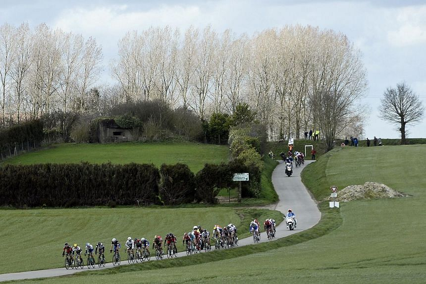 A pack of riders competing during the 78th edition of the Gent-Wevelgem race on March 27, 2016.