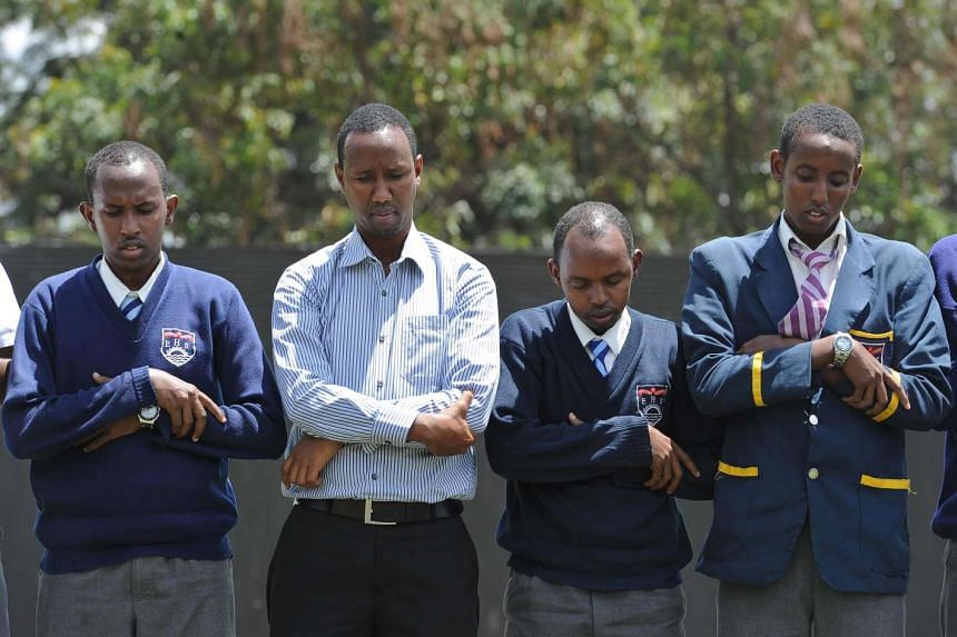 Mr Mohamud (second from left) at a midday prayer with students. He has started an initiative called Teachers Against Violent Extremism.