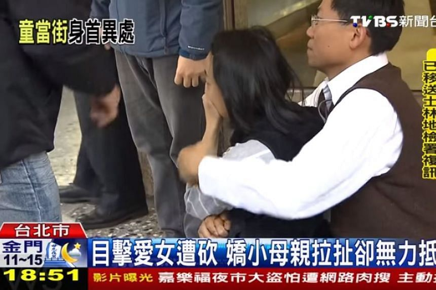 Grieving parents of a four-year-old girl who was decapitated by a knife-wielding man in Taipei.