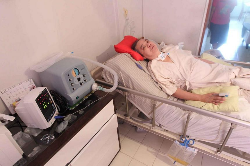Mr Aw Kian Chow was paralysed from the neck down after a fall on a walkway near his former home.