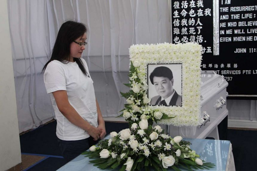 Madam Angeline Zeng grieves at Mr Aw Kian Chow's wake.