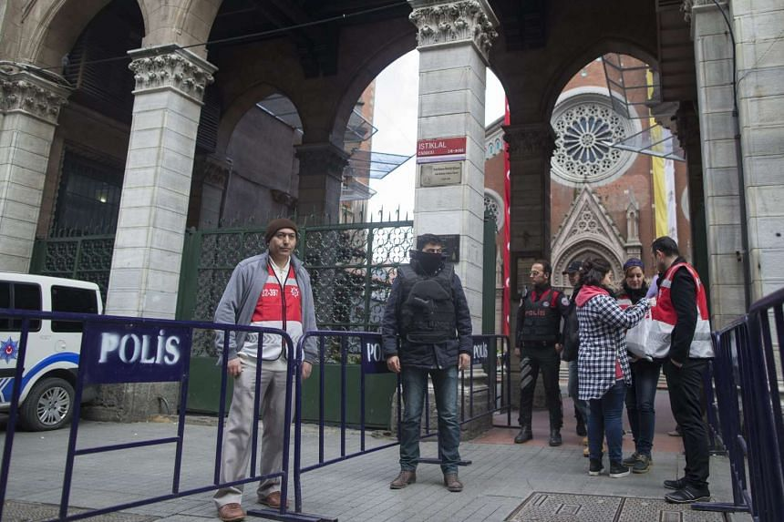Turkish police guarding the St Antouan Church in Istanbul on March 26, 2016.