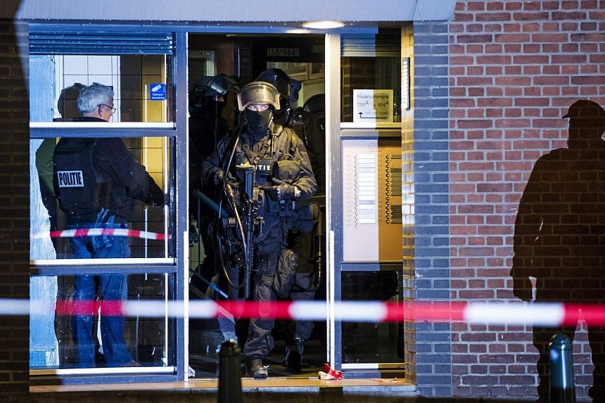 Dutch police conduct a raid in Rotterdam-West, on March 27, where they arrested a 32-year-old Frenchman suspected of receiving orders from ISIS.