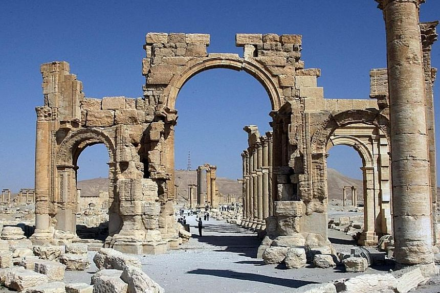 Archaeologists rushed to the ancient city of Palmyra on Sunday to assess the damage wreaked by the Islamic State in Iraq and Syria (ISIS) after it was ousted by the Syrian army in a bloody battle. The picture on the left shows all that remains of the