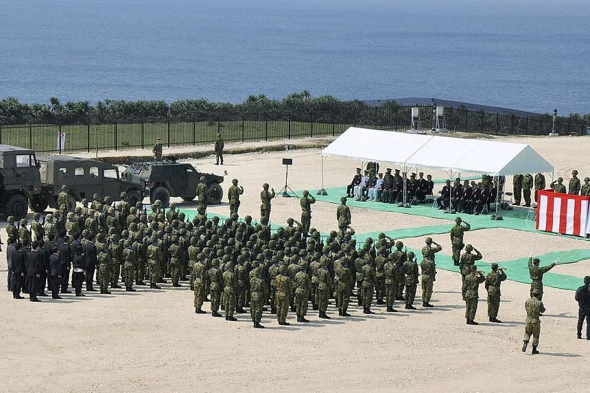 Japan's forces holding an opening ceremony at the new base on Yonaguni Island yesterday.