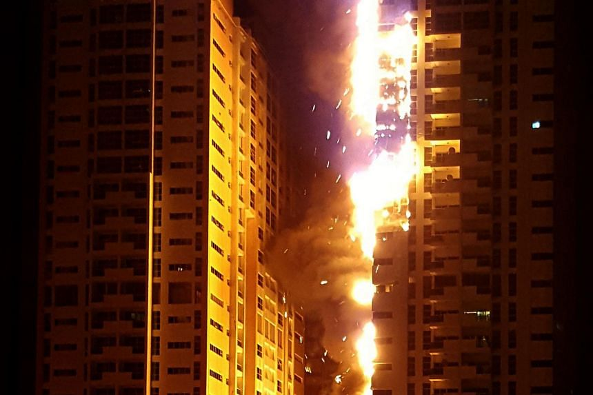 Fire engulfs a tower at a residential cluster in Ajman, in the United Arab Emirates, on March 28, 2016.