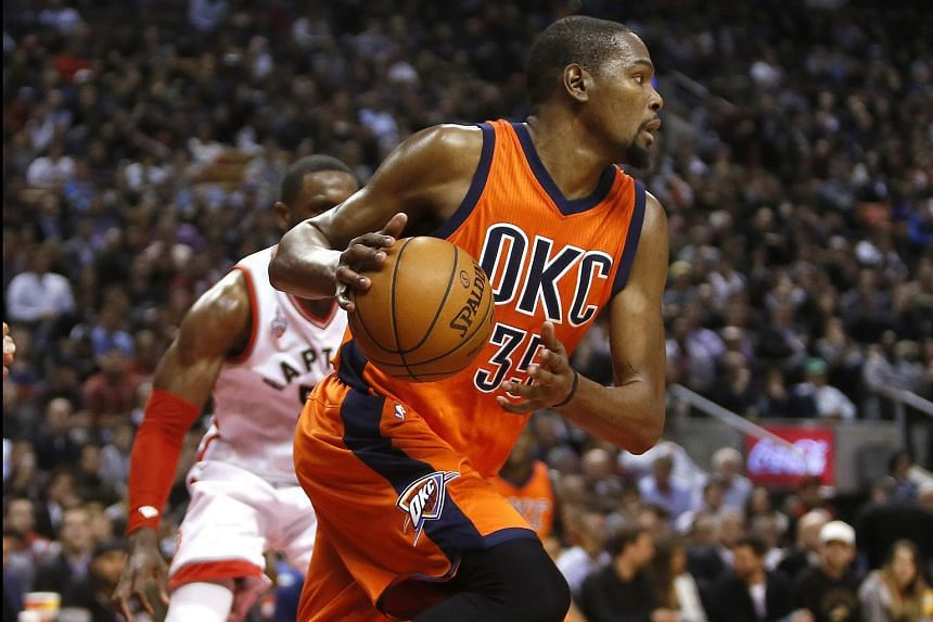 Oklahoma City Thunder forward Kevin Durant heads up court against the Toronto Raptors at the Air Canada Centre.