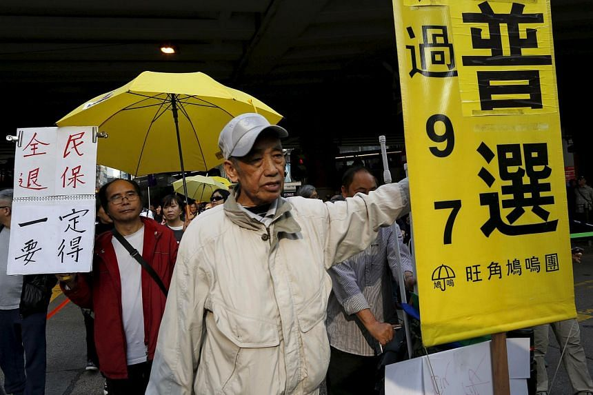 Demonstrators taking part in an annual New Year's Day march with yellow umbrellas, a symbol of the Occupy Central movement, in Hong Kong on Jan 1.