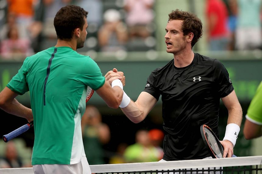 Grigor Dimitrov (left) is congratulated by Andy Murray after their match during the Miami Open.