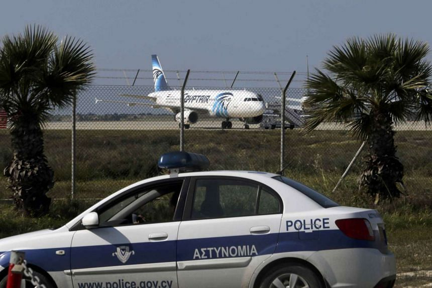 Police standing guard at Larnaca Airport near a hijacked Egypt Air Airbus A320, on March 29, 2016.