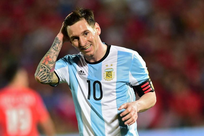 Lionel Messi smiles during the Russia 2018 Fifa World Cup South American Qualifiers' football match against Chile, in Santiago, on March 24, 2016.
