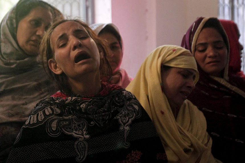 Family members mourn the death of a relative, who was killed in a blast that happened outside a public park in Lahore, on March 28, 2016.