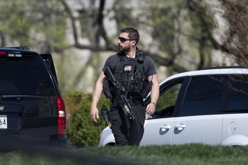 A US Secret Service Officer patrols the North Lawn during a lockdown of the White House in Washington, DC, on Monday (March 2016).