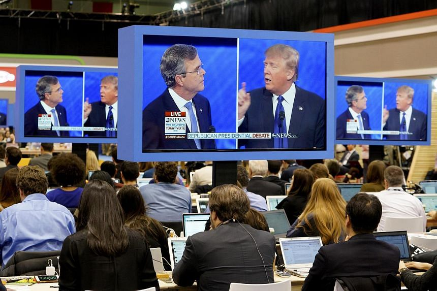 Journalists watch the debate on monitors in the media filing centre during the Republican US presidential candidates debate in New Hampshire, on Feb 6, 2016.