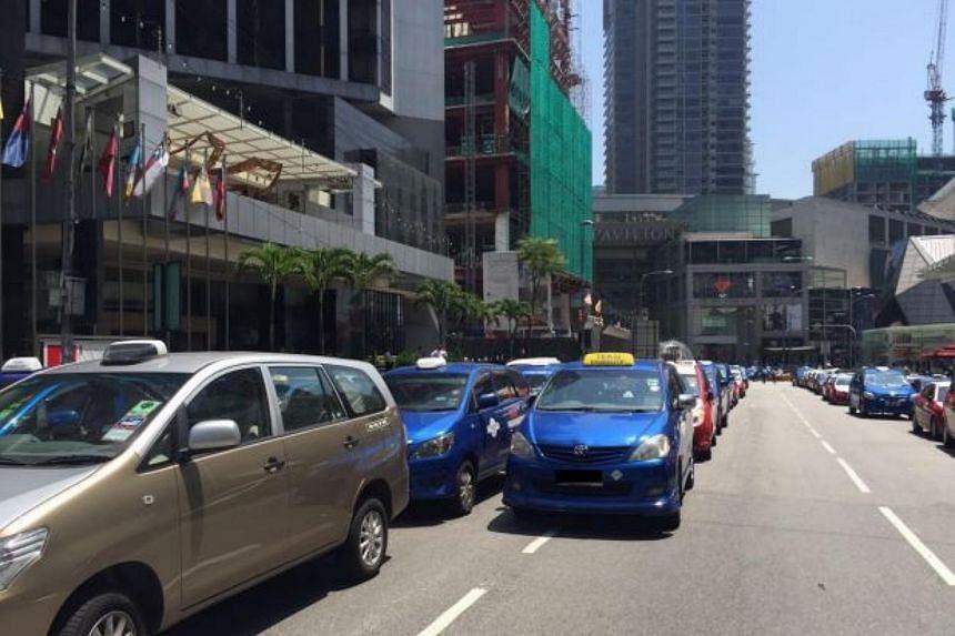 Taxis outside Pavilion Kuala Lumpur.