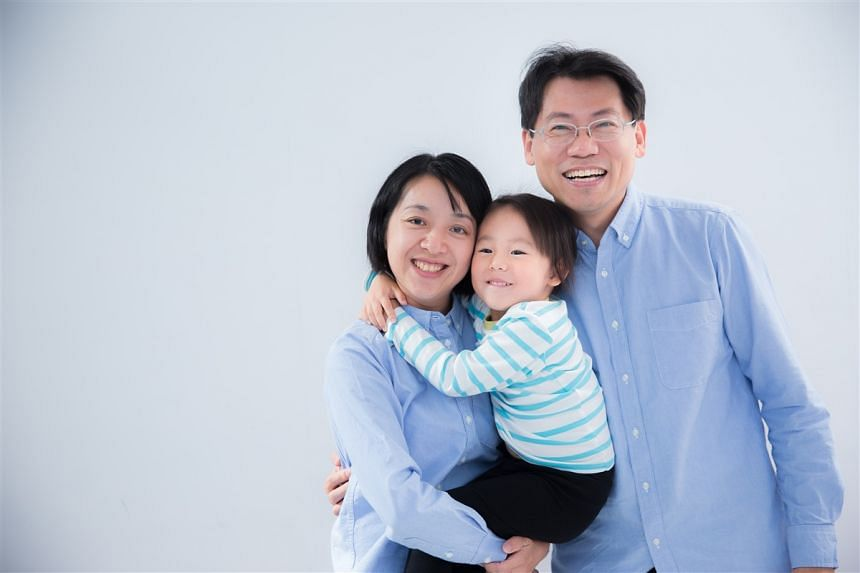 Ms Claire Wang with her daughter, whose nickname was Little Light Bulb, and husband.