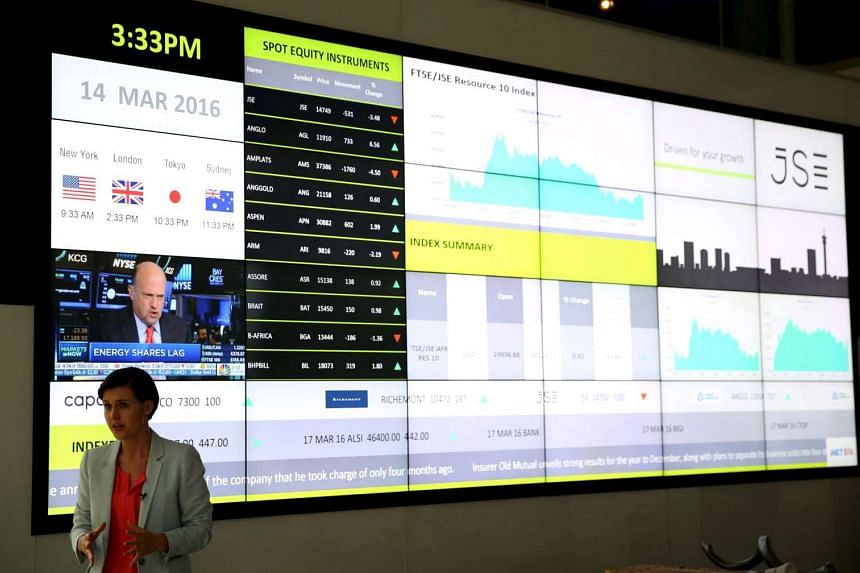 An electronic board displaying movements in major indices at the Johannesburg Stock Exchange building in Sandton Johannesburg, on March 14, 2016.