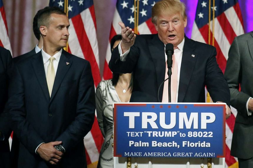 Campaign manager Corey Lewandowski (left) stands next to Republican U.S. presidential candidate Donald Trump during a news conference in Palm Beach, Florida, in this file photo taken on March 15, 2016.