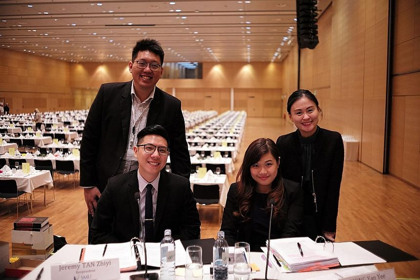 The Singapore Management University team for the Willem C. Vis competition held in Vienna comprises (standing) Mr Won Chian Lim, 27, and Ms Tiffany Tseng, 30, as well as (seated) Mr Jeremy Tan Zhiyi, 25, and Ms Wong Yan Yee, 21. They went up against