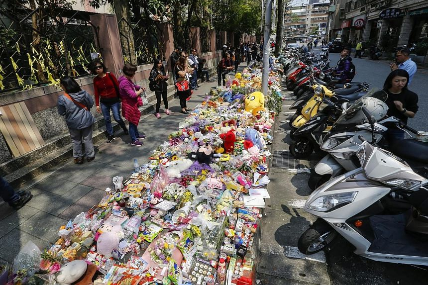 A makeshift memorial site of flowers and soft toys for the girl who was killed on Monday, near where she was attacked, on the outskirts of Taipei. The attacker had followed the girl and her mother for an hour before killing her with a kitchen knife.