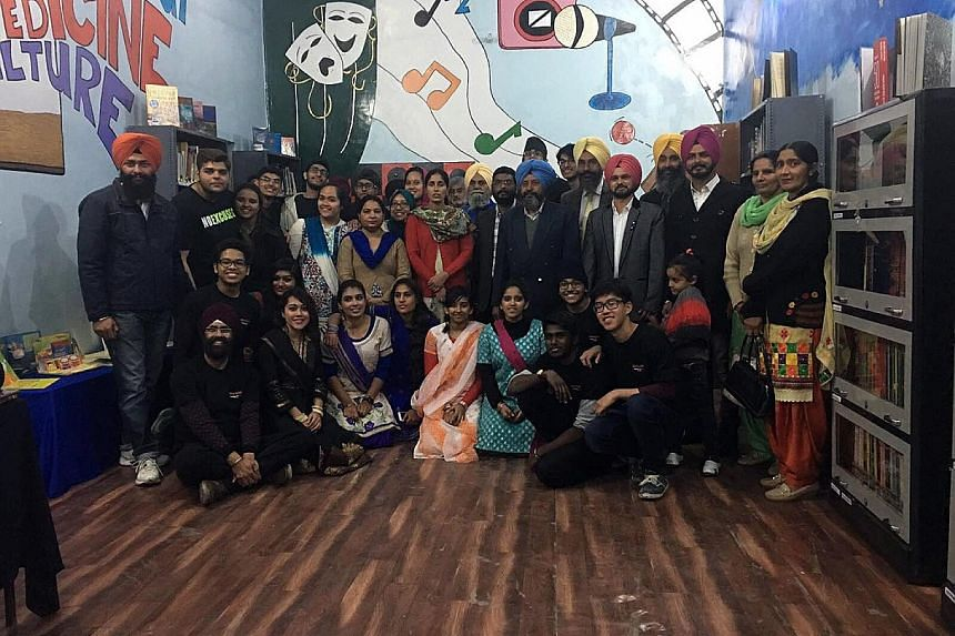 The YSA community service team and teachers of the Punjab school in the newly built library. About two dozen volunteers went to the Ludhiana district in December to install a power generator and build a school library.