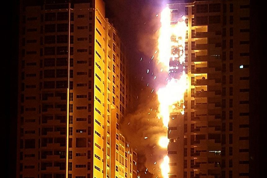 A fire broke out in a building in Ajman One, a residential cluster of 12 towers in the United Arab Emirates, on Monday. Five people were treated for injuries. The fire gutted at least two towers in the fourth major high-rise fire in the UAE in three