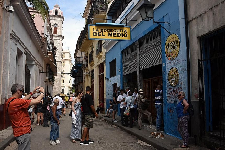 Crowds outside one of Havana's most emblematic bars, the La Bodeguita del Medio. Cuba is the newest aspirant at the door of globalisation.
