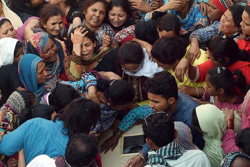 Pakistani Christians at a funeral for a victim of the March 27 suicide bombing, in Lahore, on Monday. The bomber, targeting Christians, killed 73 people, including children, in a crowded park.