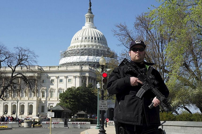 A police officer guarding the perimeter of the US Capitol building after the shooting at its visitor centre on Monday.