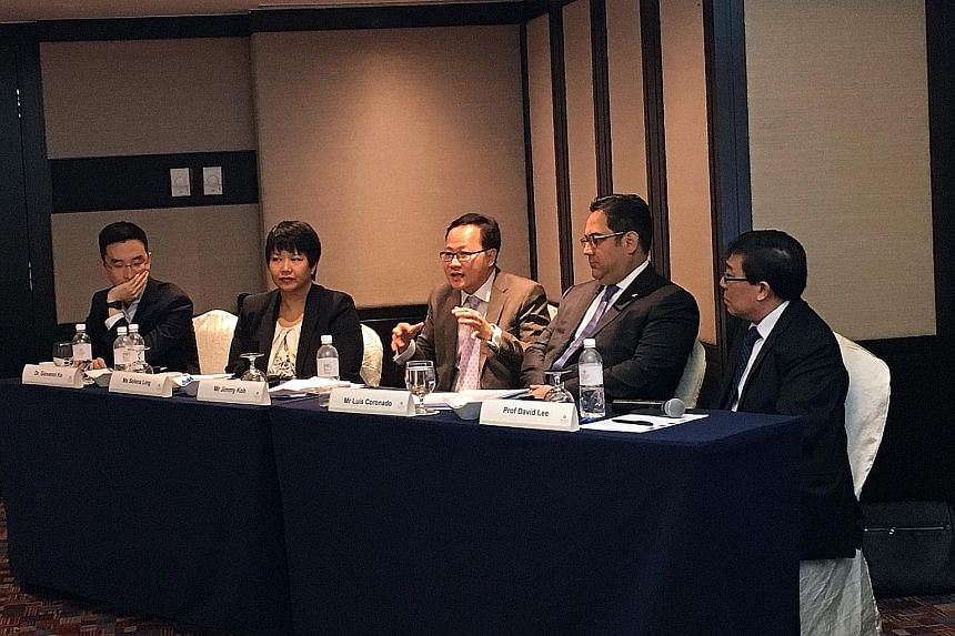 Members of the panel at yesterday's post-Budget roundtable: (from left) Dr Ko, Ms Ling, Mr Koh, Mr Coronado and Dr Lee. They noted that the Budget put heavy emphasis on automation, innovation and preparing for the future, but said more still needs to