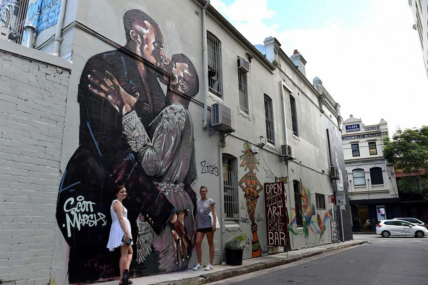 A large mural of US rapper Kanye West seemingly in an embrace with himself in Sydney on March 30, 2016.