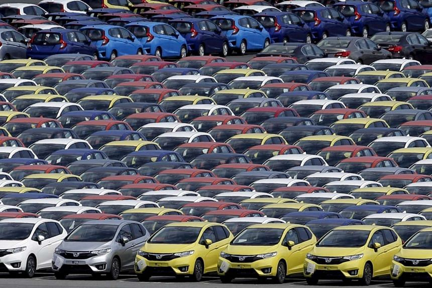 Newly manufactured cars await export at a port in Yokohama.