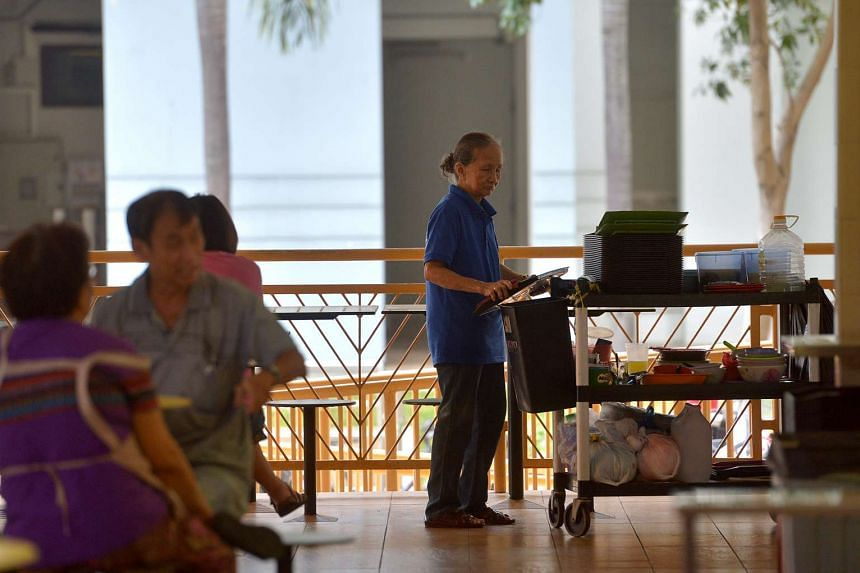 An elderly cleaner at a hawker centre.