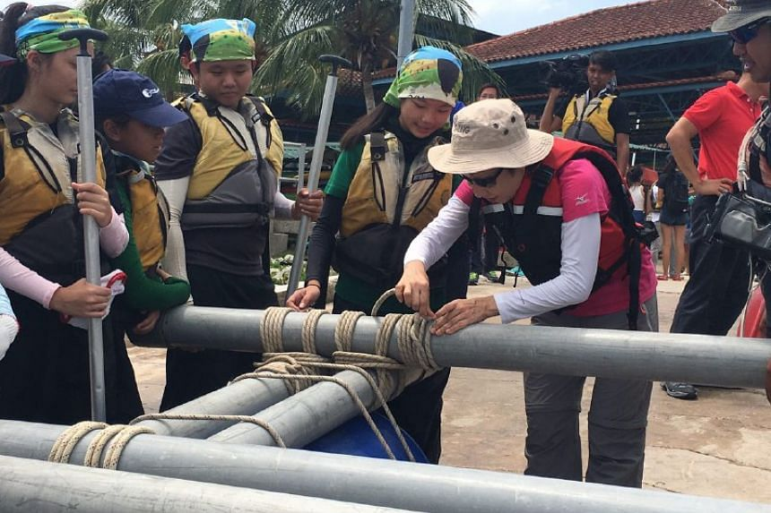 Minister Grace Fu helping to construct a raft at OBS Ubin.