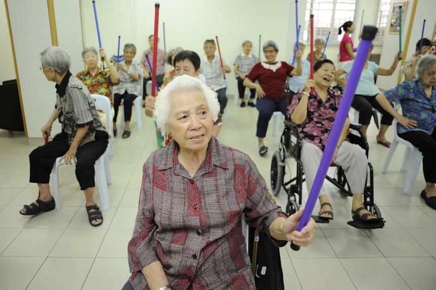Elderly folk participating in an exercise session at Henderson Senior Citizens' Home in 2011.