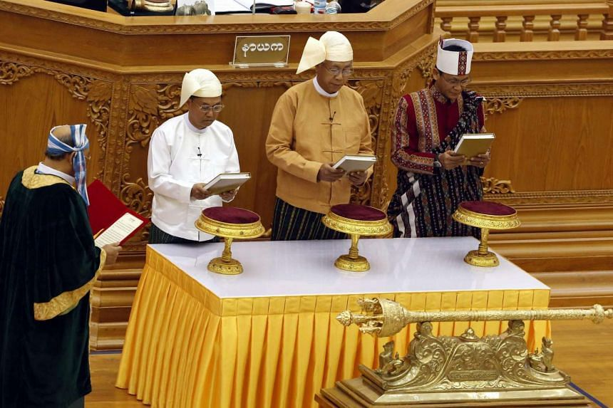 Myanmar President Htin Kyaw (C), and Myanmar Vice Presidents Myint Swe (L) and Henry Van Thio (R) are sworn in during the oath taking ceremony at the Union Parliament in Naypyitaw, Myanmar, 30 March 2016. It is the first Myanmar's elected civilian-le