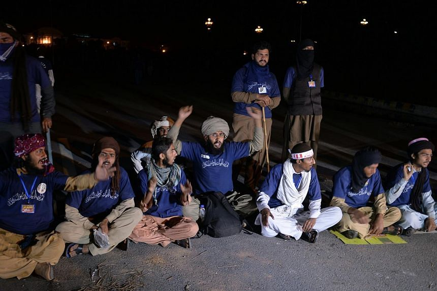 Supporters of executed Islamist Mumtaz Qadri sit in during an anti-government protest in front of the Parliament building in Islamabad on March 29, 2016.