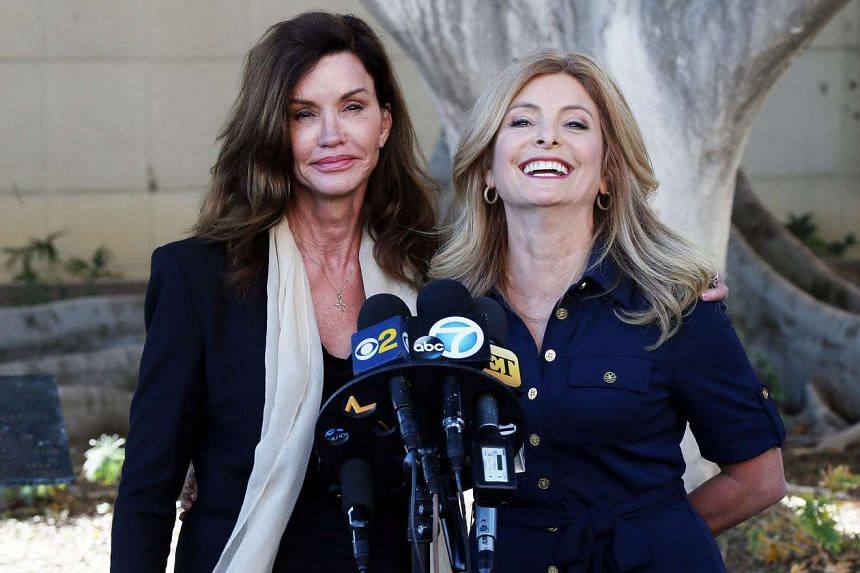 Janice Dickinson (left) and her lawyer Lisa Bloom at a press conference at a motions hearing in her lawsuit against comedian Bill Cosby.