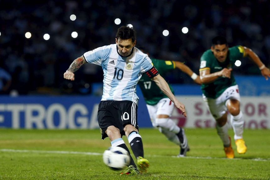 Lionel Messi scores a penalty during the World Cup 2018 Qualifier football match between Argentina and Bolivia.