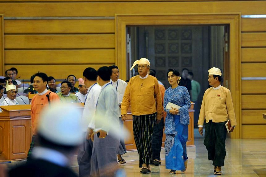 Myanmar's new president Htin Kyaw (third from right), National League for Democracy party leader Aung San Suu Kyi (second from right) and Speaker of lower house of parliament Win Myint arrive at union parliament in Naypyitaw, Myanmar.