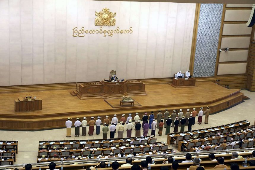 Myanmar democracy leader Aung San Suu Kyi (middle line, ninth from right) and appointed ministers for the new Myanmar cabinet member swear in during the oath taking ceremony at the Union Parliament in Naypyitaw, Myanmar.